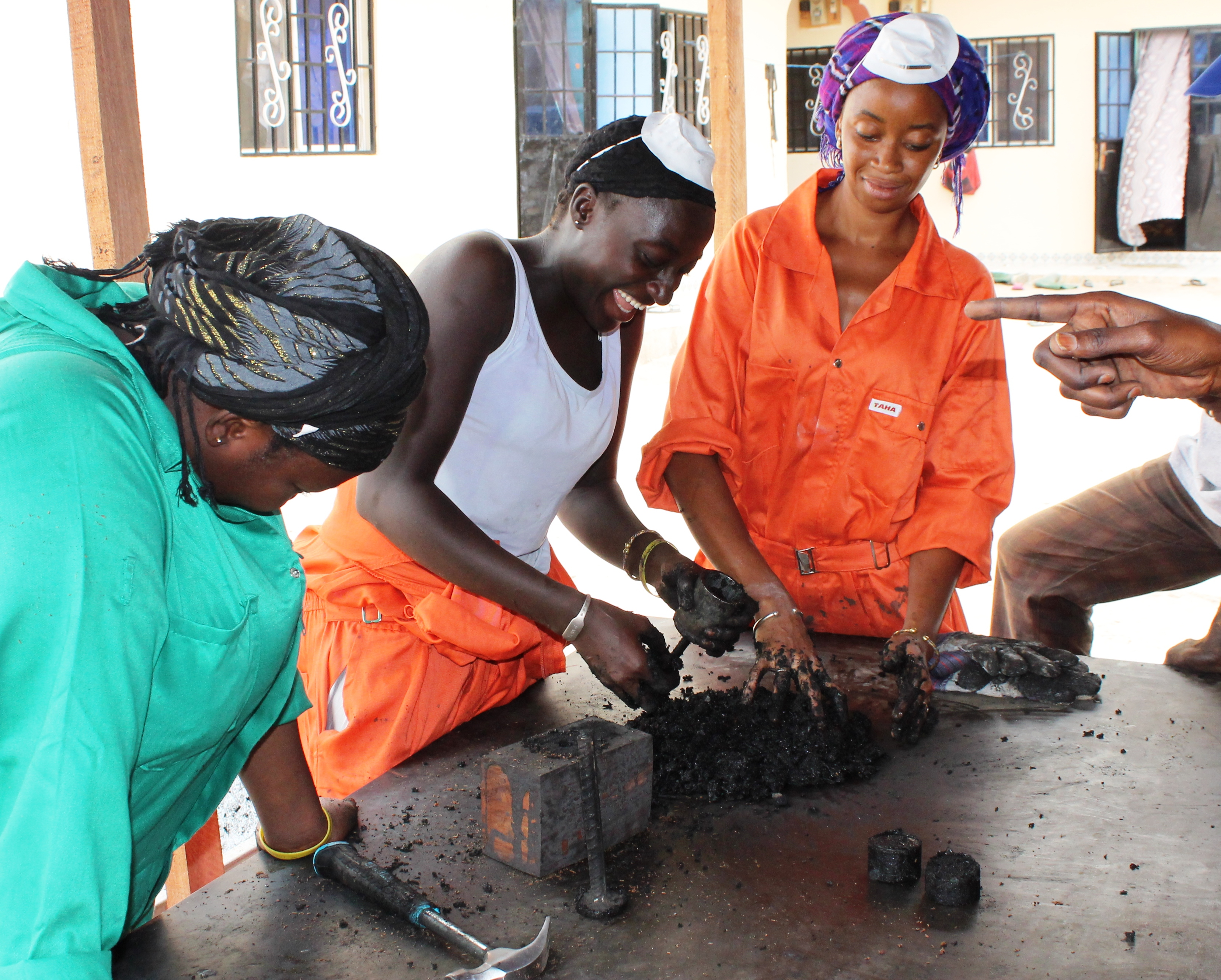 WasteAid trainees making charcoal briquettes from organic waste