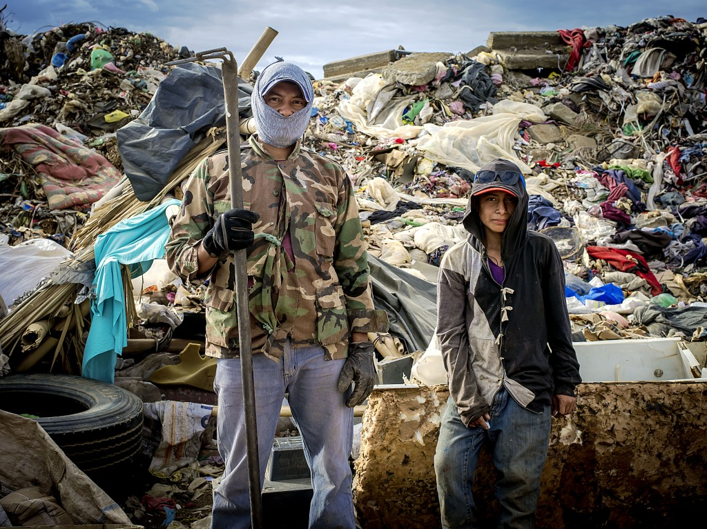 A father and son work together sorting garbage in the trash dump of Masaya, Nicaragua. It is common for the entire family to work together; meaning this health risk will exist for generations. Photo by: Timothy Bouldry, 2015.
